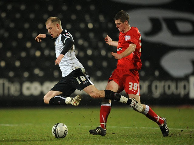 Preston North End's Andrew Procter and Notts County's Neal Bishop battle for the ball on January 24, 2012