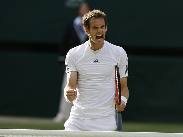 Andy Murray reacts after beating Mikhail Youzhny during their Wimbledon match on July 1, 2013