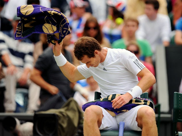 Great Britain's Andy Murray throws his towel down in his match against Spain's Fernando Verdasco during day nine of the Wimbledon Championships on July 3, 2013