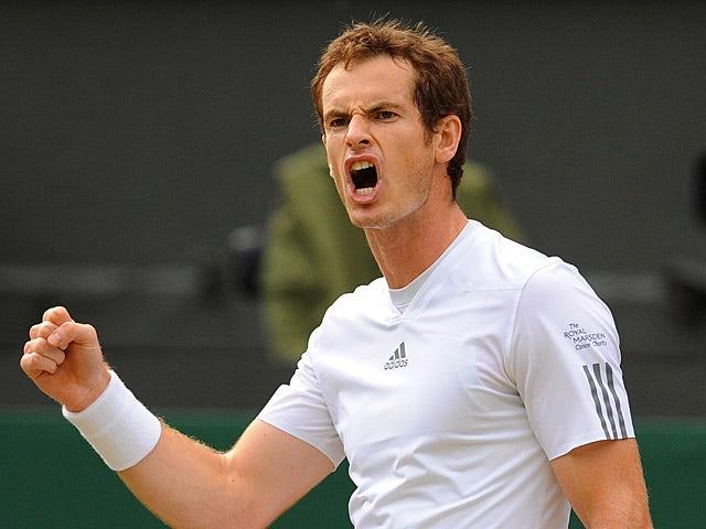 Andy Murray celebrates winning a point against Fernando Verdasco during their quarter final match at Wimbledon on July 3, 2013