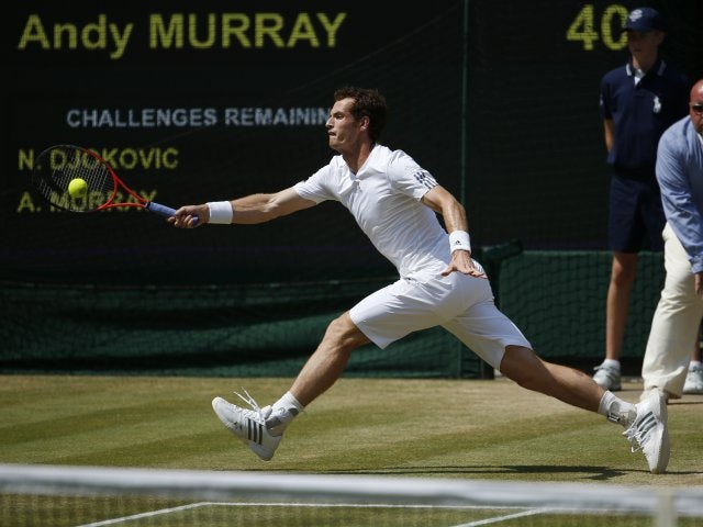 Andy Murray stretches to play a shot in the men's final at Wimbledon.