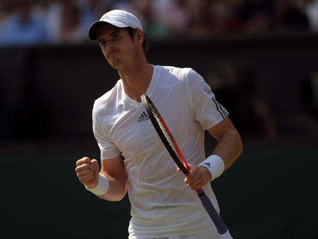 Great Britain's Andy Murray celebrates a point against Serbia's Novak Djokovic during the final of Wimbledon on July 7, 2013