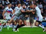 Daniel Holdsworth is tackled by Wakefield Wildcats' Danny Kirmond and Oliver Wilkes during their Super League match on July 1, 2013