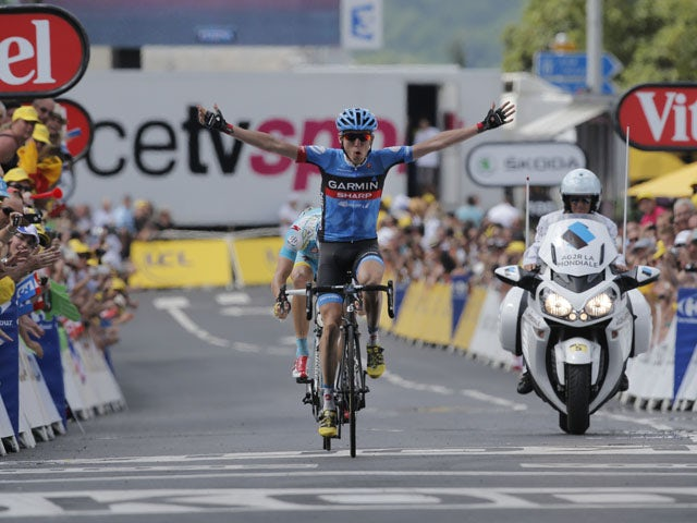 Daniel Martin of Ireland crosses the finish line ahead of Jakob Fuglsang of Denmark to win the ninth stage of the Tour de France on July 7, 2013