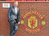 New Manchester United manager David Moyes poses for pictures in the home team dug out on July 5, 2013