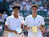 Winner Italy's Gianluigi Quinzi with Korea's Hyeon Chung following the Boys' Singles Final on July 7, 2013
