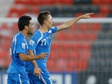Uzbekistan's Igor Sergeev celebrates after scoring his team's second against Greece during the U20 World Cup on July 2, 2013