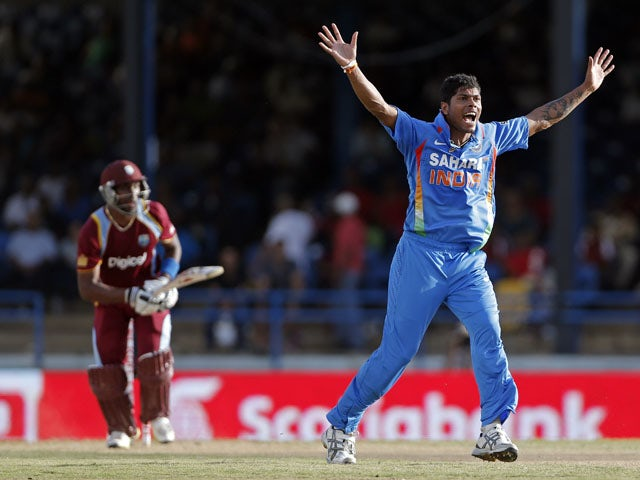 India bowler Umesh Yadav appeals successfully for the LBW of West Indies captain Dwayne Bravo on July 5, 2013