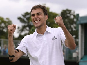 Result: Janowicz through to last eight
