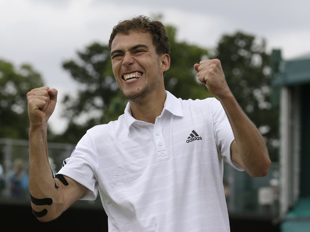 Jerzy Janowicz of Poland reacts after beating Jurgen Melzer of Austria during their Men's singles match on July 1, 2013
