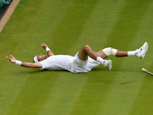 Argentina's Juan Martin Del Potro celebrates defeating Spain's David Ferrer on day 9 of the Wimbledon Tennis Championships on July 3, 2013