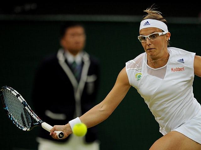 Kirsten Flipkens returns the ball to opponent Petra Kvitova during their Wimbledon quarter final match on July 2, 2013