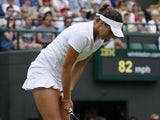 Great Britain's Laura Robson reacts after losing the first set in her match against Estonia's Kaia Kanepi during day seven of the Wimbledon Championships on July 1, 2013
