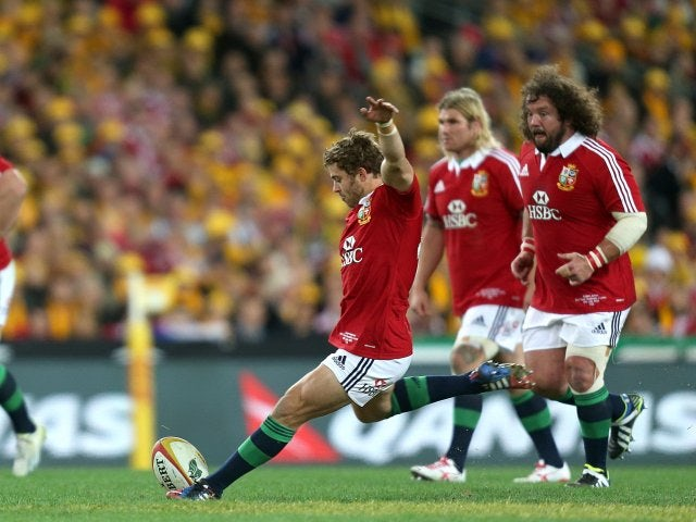 Leigh Halfpenny kicks between the posts for the Lions.