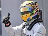 Lewis Hamilton celebrates gaining pole position at the German GP on July 6, 2013