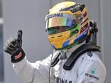 Lewis Hamilton celebrates gaining pole position at the German GP on July 6, 2013