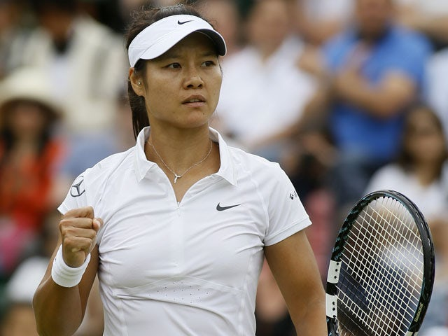Li Na of China reacts after winning a point against Roberta Vinci of Italy during a Women's singles match at the All England Lawn Tennis Championships on July 1, 2013