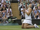 Marion Bartoli celebrates beating Kirsten Flipkens on July 4, 2013