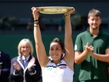 Marion Bartoli celebrates winning Wimbledon on July 6, 2013