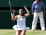 France's Marion Bartoli celebrates after beating Germany's Sabine Lisicki during the 2013 Wimbledon final on July 6, 2013