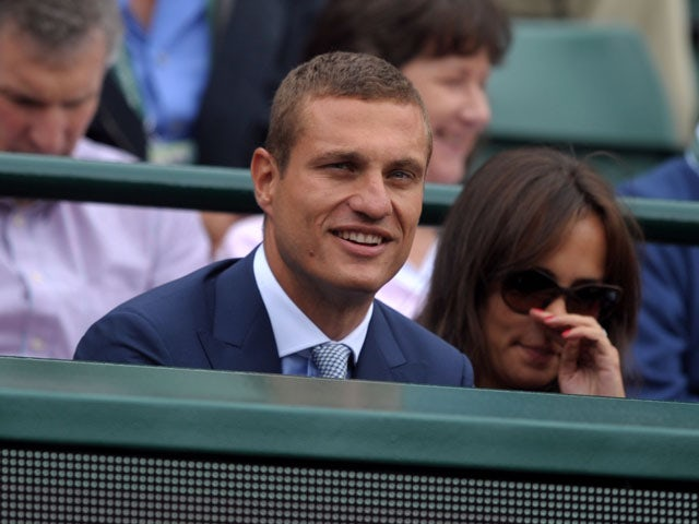 Nemanja Vidic watches the match between Serbia's Novak Djokovic and Czech Republic's Tomas Berdych on July 3, 2013