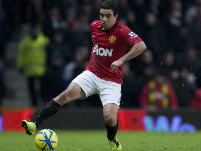 Manchester United defender Rafael da Silva controls the ball.