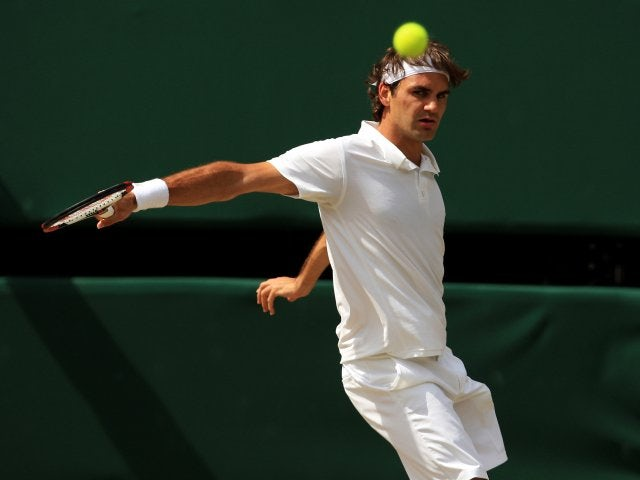 Roger Federer plays a shot during the 2008 Wimbledon final.