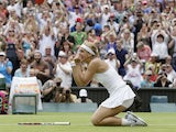 Sabine Lisicki of Germany reacts after beating Serena Williams of the United States in a Women's singles match on July 1, 2013
