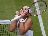 Sabine Lisicki celebrates after beating Kaia Kanepi during their Wimbledon quarter final match on July 2, 2013