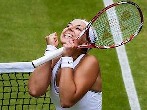 Sabine Lisicki celebrates after beating Kaia Kanepi during their Wimbledon quarter final match on July 2, 2013