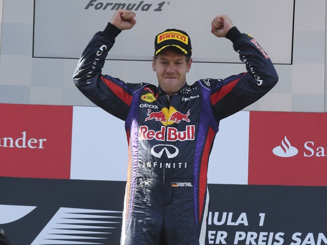Red Bull driver Sebastian Vettel of Germany celebrates on the podium after he won the German Formula One Grand Prix on July 7, 2013