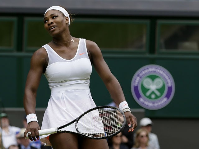 Serena Williams of the United States reacts during her match against Sabine Lisicki of Germany in a Women's singles on July 1, 2013