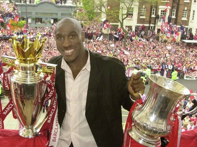 Sol Campbell celebrates winning the double with Arsenal.