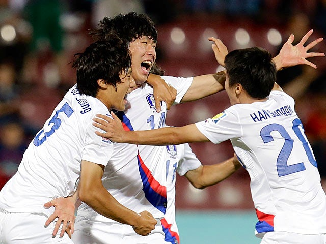 South Korea's Song Juhun celebrates with team mates after scoring the opening goal against Colombia in the U20 World Cup on July 3, 2013