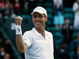 Tomas Berdych punches the air after defeating Bernard Tomic during their Wimbledon match on July 1, 2013