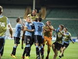 Uruguay players celebrate after scoring the opening goal during extra time of a Under-20 World Cup quarter final soccer match between Uruguay and Spain on July 6, 2013