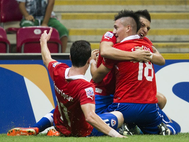 Chile's Nicolas Castillo celebrates scoring during the Under-20 World Cup quarter final soccer match between Ghana and Chile on July 7, 2013