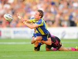 Warrington Wolves' Brett Hodgson is tackled by Leeds Rhinos Joel Moon during the Super League on July 5, 2013