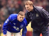 David Moyes passes out instructions to Wayne Rooney.