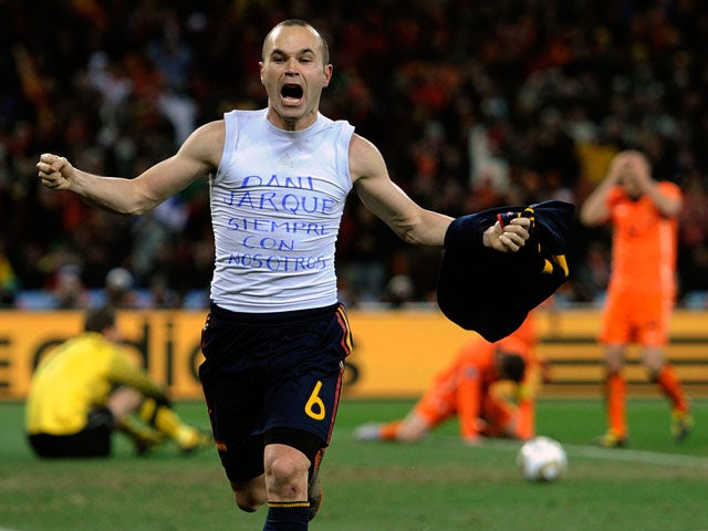 Spain's Andres Iniesta celebrates after scoring during the 2010 World Cup Final on July 11, 2010