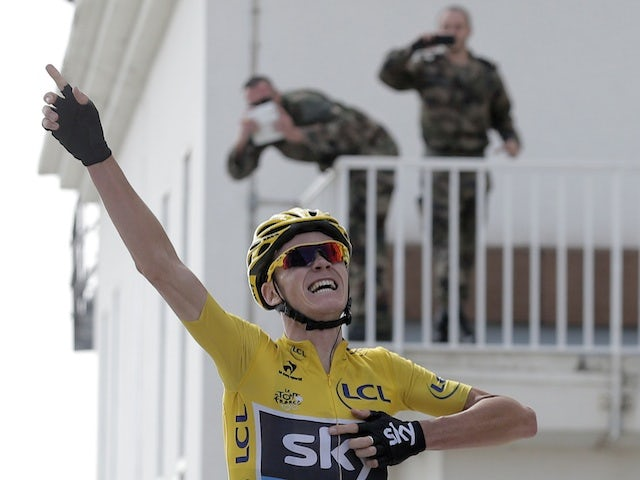 Chris Froome celebrates winning Stage 15 of the Tour de France on July 14, 2013