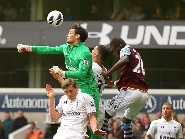 Christian Benteke attempts to outjump Hugo Lloris.