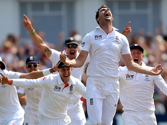 England's James Anderson and team mates celebrate after winning the First Ashes Test match at Trent Bridge on July 14, 2013