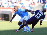 Manchester City's Micah Richards and SuperSport's Innocent Mdledle battle for the ball during their Nelson Mandela Football Invitational match on July 14, 2013