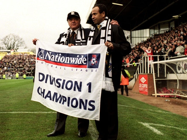 Fulham's Owner Mohamed Al Fayed celebrates with manager Jean Tigana as they are named Division 1 Champions on April 16, 2001
