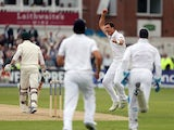 England's bowler Steven Finn celebrates taking the wicket of Australia's Ed Cowan during day one of the first Ashes Test on July 10, 2013