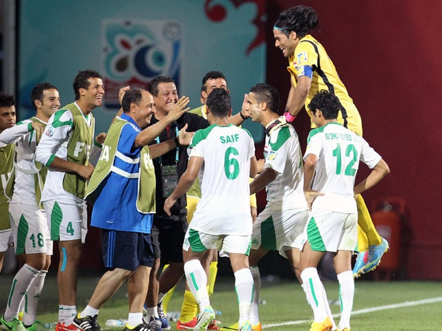 The Iraq team celebrates the opening goal against Uruguay during their Under-20 World Cup semi final match on July 10, 2013