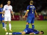 Zinedine Zidane looks on after headbutting Marco Materazzi.