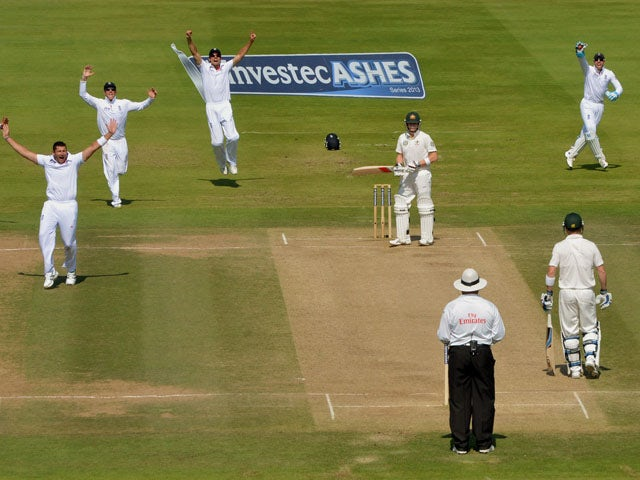 England's Tim Bresnan celebrates taking the wicket of Australia's Steven Smith on day four of the Second Investec Ashes Test on July 21, 2013