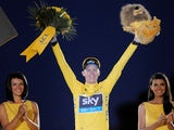 Chris Froome celebrates on the podium after winning the Tour de France on July 21, 2013